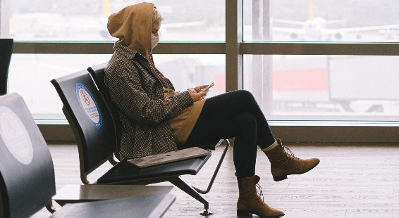 Woman in airport with mobile